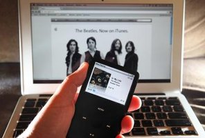 You can copy your music to an iPod with iTunes.