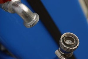 A drip irrigation system taps into water supply lines at a standard hose faucet.