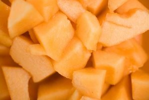 Bright orange cantaloupe cubes add flavor and color to ice cream.