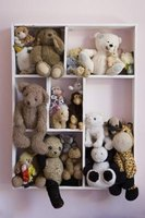 This wall shelf makes a cozy home for stuffed animals.