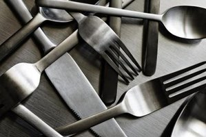 Polish your metal flatware with products in your kitchen.