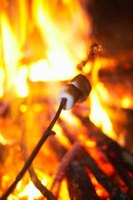 Roast marshmallows around the campfire while performing skits.