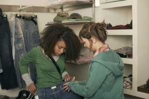 Denim visual displays help explain fit and style to the customer.