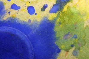 Splatter watercolor paint for dramatic, expressive effect in your artwork.