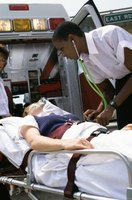 Emergency medical technicians treat patients at the scene of accidents.