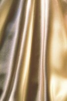 Polyester satin comes in many colors, is shiny and drapes beautifully.