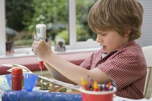 Give your children washable PVA (poly-vinyl acetate) glue for crafts.
