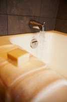 Use grab bars to help get out of the bathtub safely.
