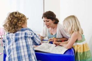 Teacher aides provide students with additional assistance in the classroom.