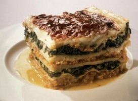 Lasagna is layered with different fillings separated by flavorful noodles.