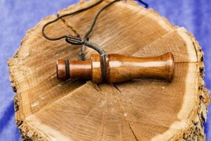 A small wooden duck call.