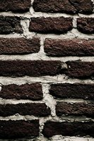 Brick walls hold signs securely with the correct fasteners.