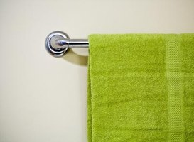 Lime green adds a pop of color to neutral bathrooms.