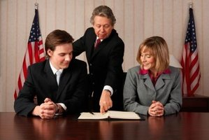 Federal employer reviews the compensation package with a new employee.