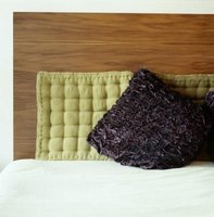 Don't rule out wood as an option for a lightweight headboard.