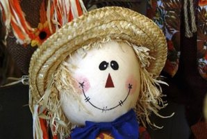 Paint a simple and sweet face on a scarecrow.