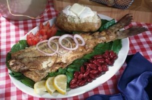 A whole catfish can be baked in the oven and served with a variety of sides.