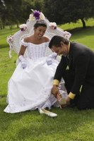 The Quinceanera's father changes her flats to high heels.