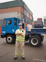 Traffic administrators work with freight carriers in importing and exporting shipments.