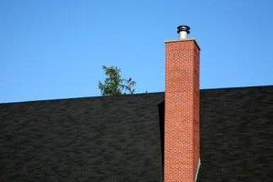 Cementitious mortar forms a water-tight bond between bricks in a chimney.