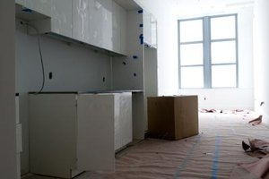 Stripping and sanding cabinets can be time consuming.