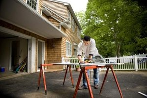 Use sawhorses or leftover lumber to support the particle board.