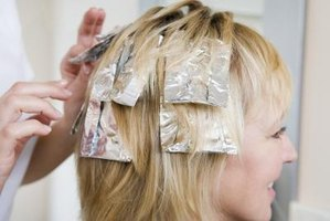Blonde streaks can be put in your hair through foil highlights.