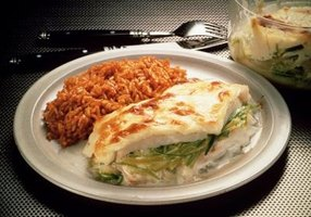 Enjoy baked cod with a side dish of seasoned rice.