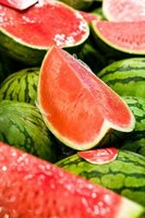 Growing watermelon at home provides your family with healthy fruit.