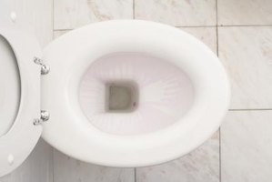 Know what happens when a toilet flush handle is depressed.