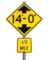 Distances shown on road signs are in statute miles.