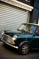 The bonnet on a Mini Cooper is the part between the two front fenders that covers the engine.