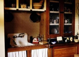 Kitchen design has changed quite a bit in the last hundred years.