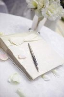 Wedding guest books may have blank pages or a wedding related prompt.
