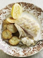 Serve cod or haddock with roasted vegetables.
