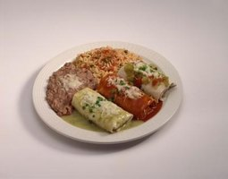 Burritos are chicken, beef, pork or bean wrapped in a tortilla.