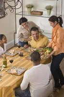 Delicious food and fun can characterize a meal at home with friends.