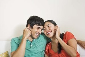Headphones with no headband make it possible to share with a friend.