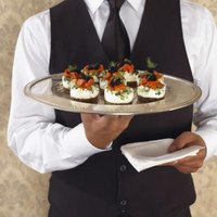 Passed appetizers are served from a tray instead of a table.