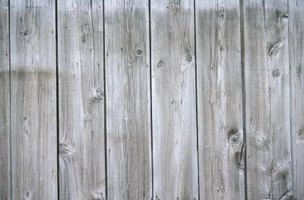 A whitewashed fence will brighten a shaded area.