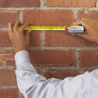 When you hang something on bricks, use a masonry drill bit and plastic plugs to avoid damage.