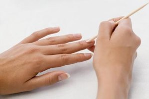 Be careful not to damage the delicate rim of skin at the base of the nail.