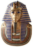 Copy the exaggerated eye makeup and gold skin tone of the Egyptian sarcophagi.