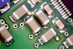 Diodes are one of the electronic components on circuit boards.