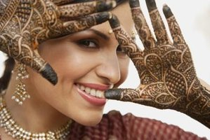 Henna tattoos are prevalent on hands.