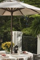A beautiful umbrella can be used on an uncovered porch for dining.