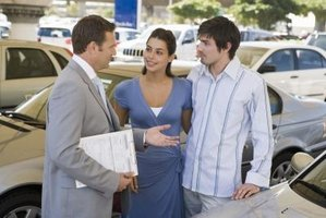 A car salesman is usually the first dealership employee customers encounter.