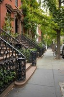 Brownstone stoop repairs are necessary to prevent further damage.