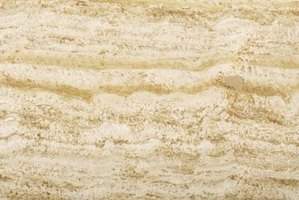 Travertine is made of limestone and is usually gold, beige or tan in appearance.