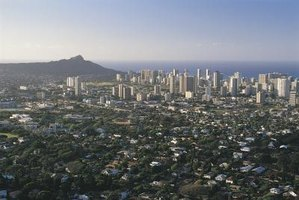 Hawaiian farmland must compete with expanding city developments.